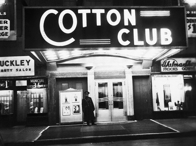 "ca. 1920s-1940s, Harlem, Manhattan, New York, New York, USA --- The night spot that best evokes glittering images of Harlem in the 1920s and 1930s is the Cotton Club. While literary urbanites appreciated Harlem Renaissance writers like Langston Hughes, more fun-loving New Yorkers were attracted to the neighborhood's vibrant cabarets. If you were white and well-heeled, you could enjoy African American entertainers like Louis Armstrong and Bill ""Bojangles"" Robinson at the elegant Cotton Club. --- Image by © Underwood & Underwood/CORBIS"